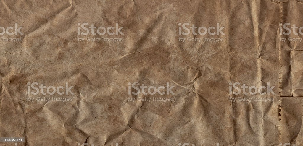 Hi-Res Old Brown Paper Grocery Bag Crushed Crumpled Grunge Texture royalty-free stock photo