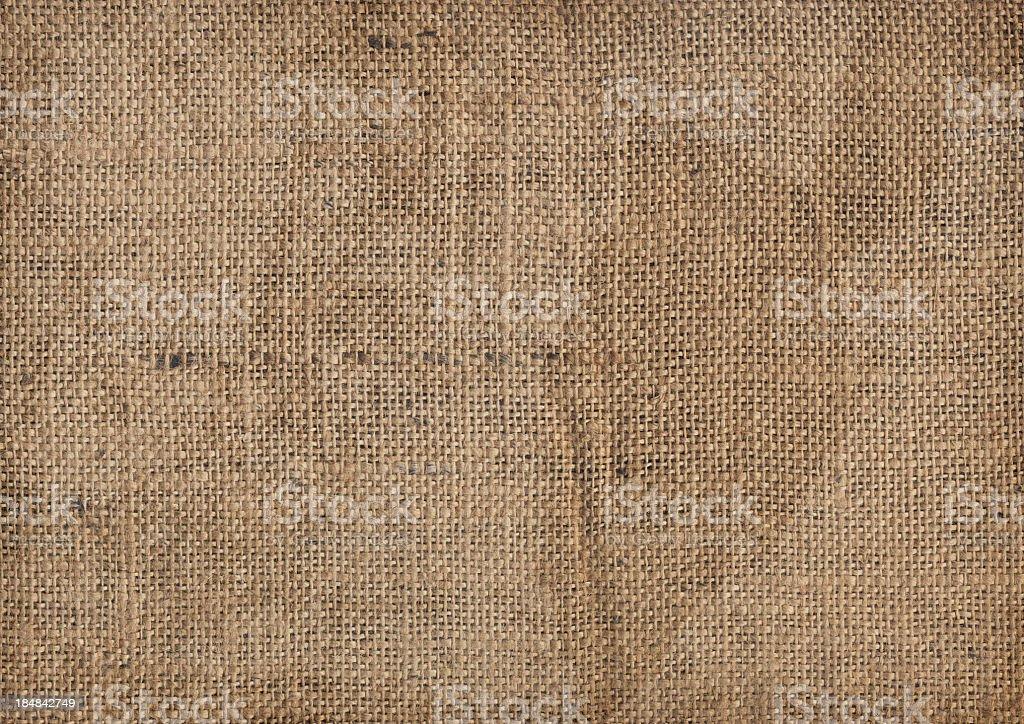 Hi-Res Old Coarse Burlap Canvas Wrinkled Dappled Vignette Grunge Texture stock photo