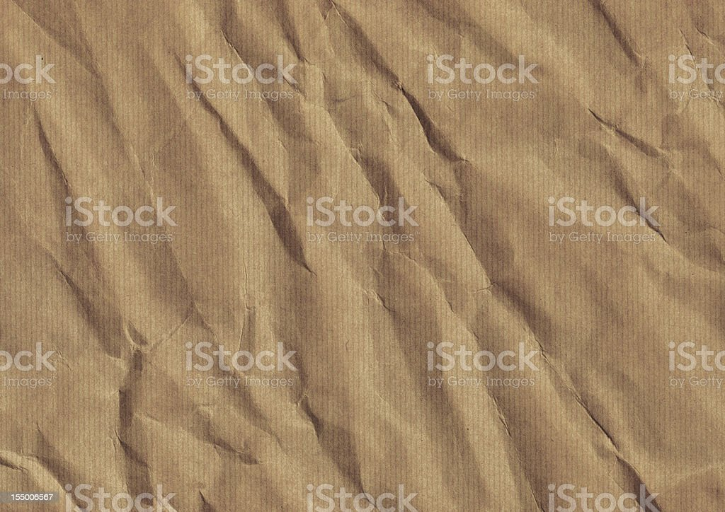 Hi-Res Old Recycle Brown Striped Kraft Paper Crushed Grunge Texture royalty-free stock photo