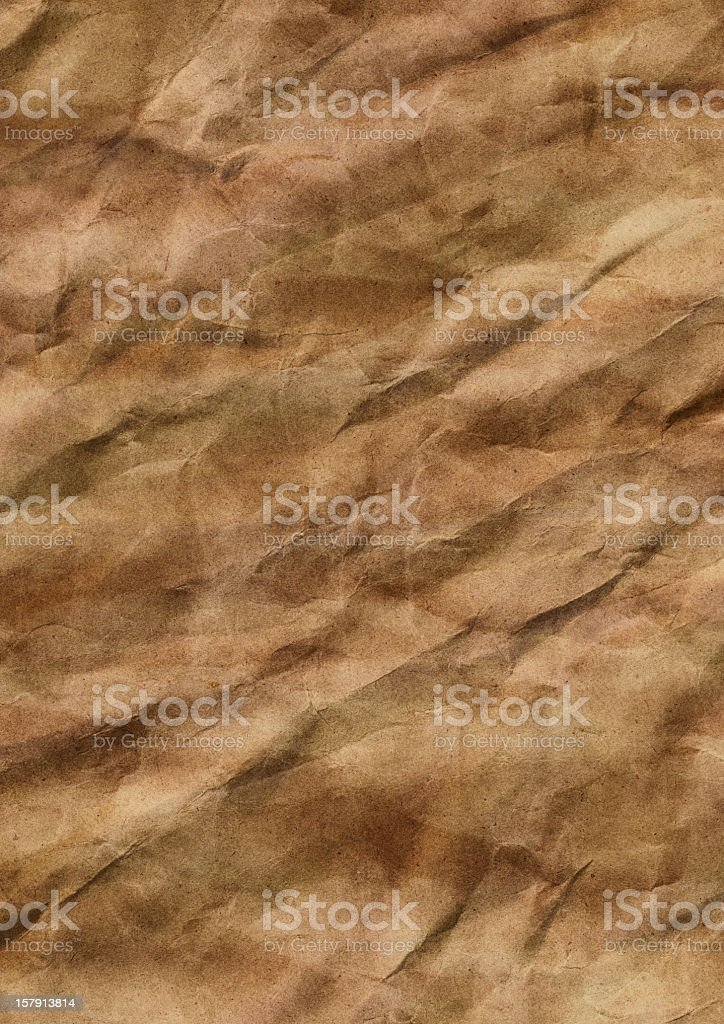 Hi-Res Old Recycled Wrapping Brown Paper Crumpled Mottled Grunge Texture royalty-free stock photo