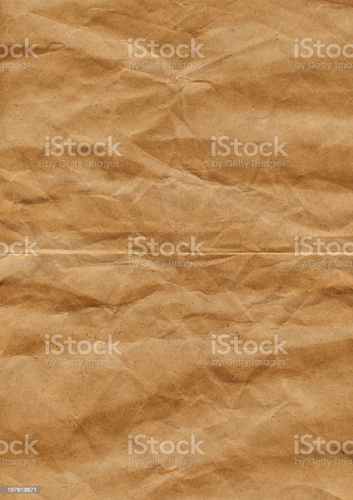 Hi-Res Old Recycled Wrapping Brown Paper Crushed Crumpled Grunge Texture royalty-free stock photo