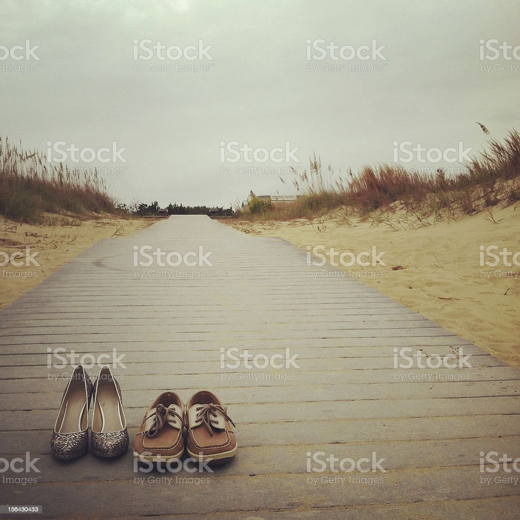 His & hers shoes on the boardwalk - mobilestock royalty-free stock photo