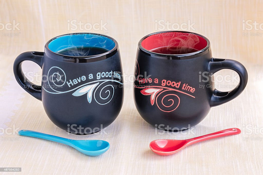 His and Her Mugs of Tea stock photo
