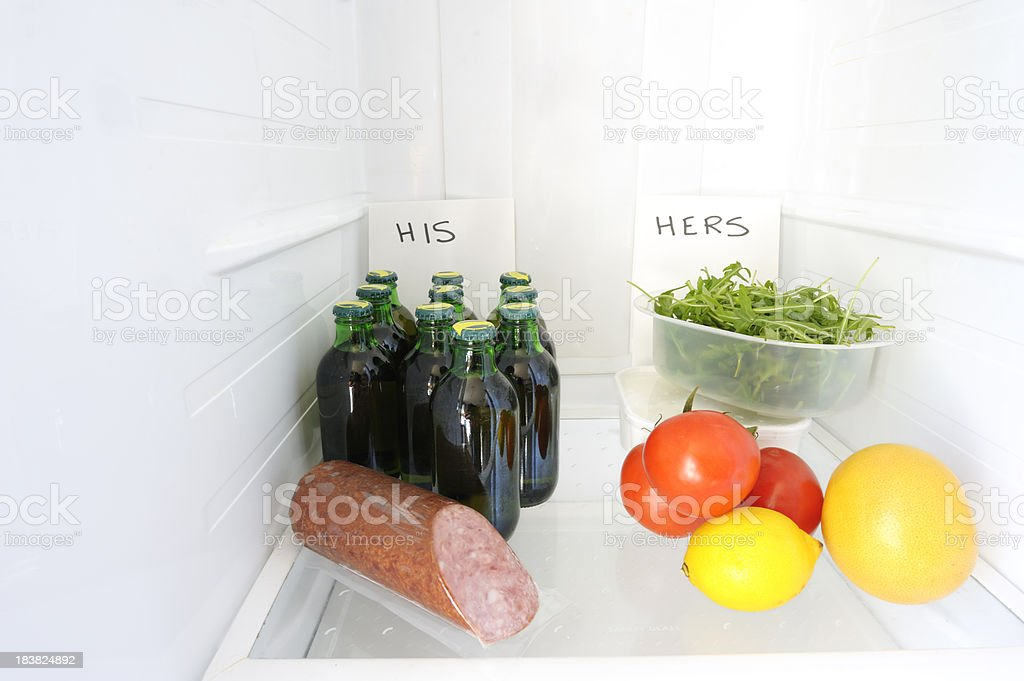 His and her unhealthy/healthy food in fridge stock photo