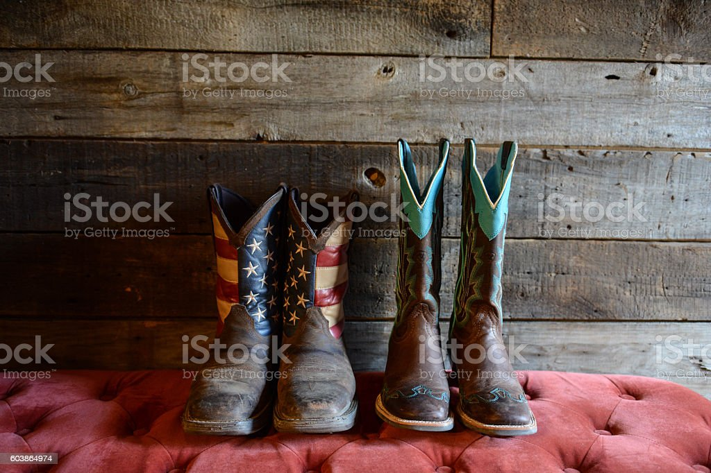 his and hers boots stock photo