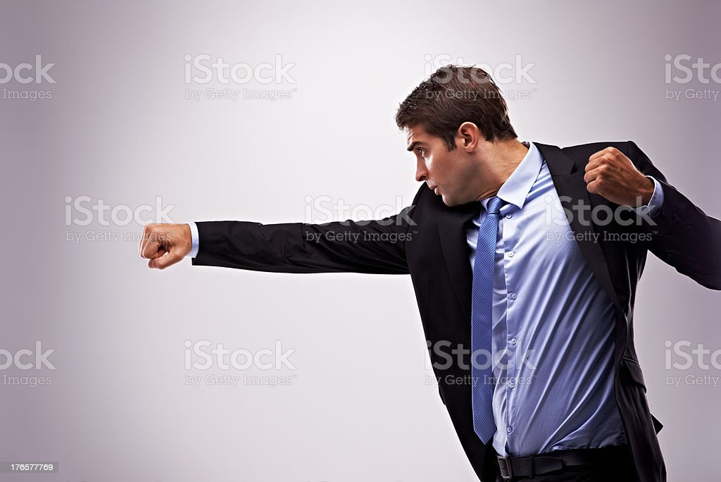 His business tactics packs a punch! stock photo