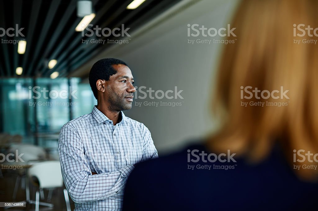 His coworkers respect his opinions stock photo