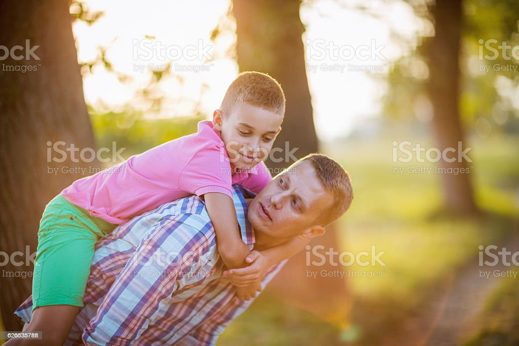 His daddy and his hero stock photo