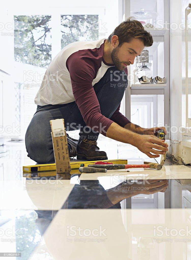 His DIY skills will floor you stock photo
