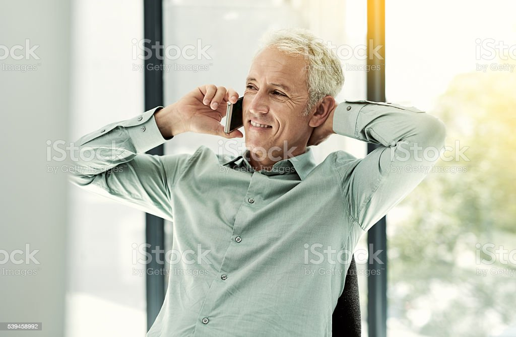 His easy going attitude keeps the clients coming back stock photo