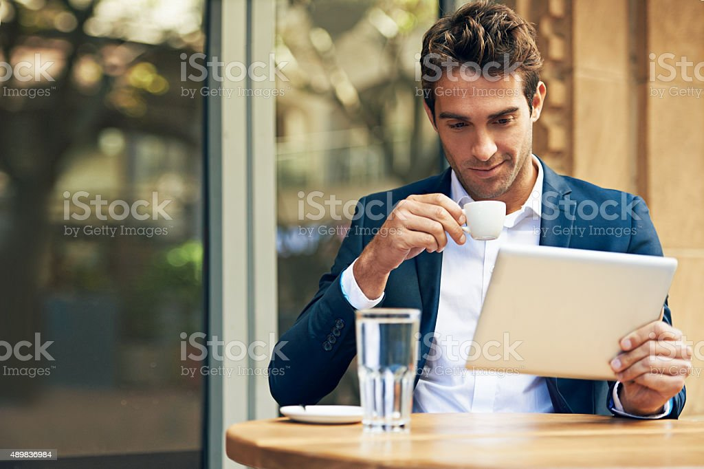 His favorite place for coffee and wifi stock photo