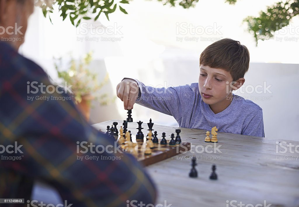 His granddad is a worthy adversary stock photo
