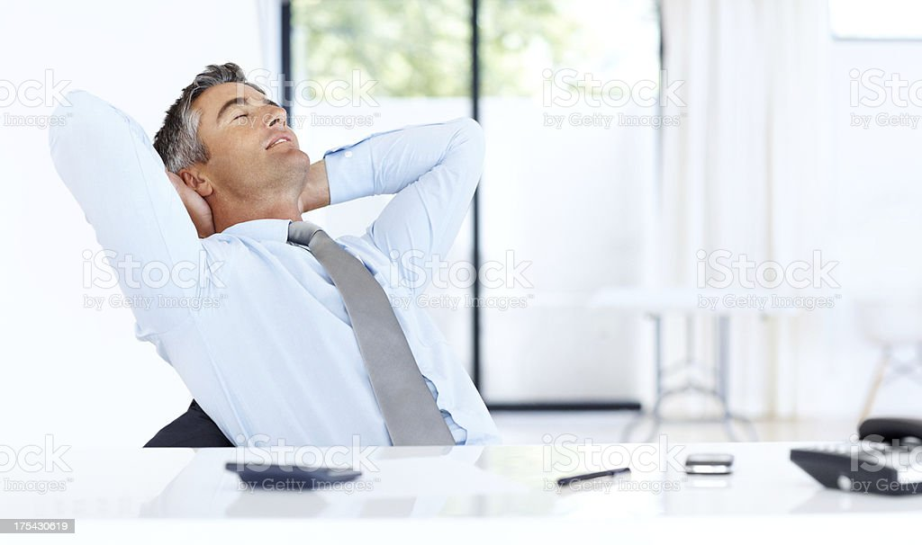 His hard day's work is finally done, successfully! stock photo