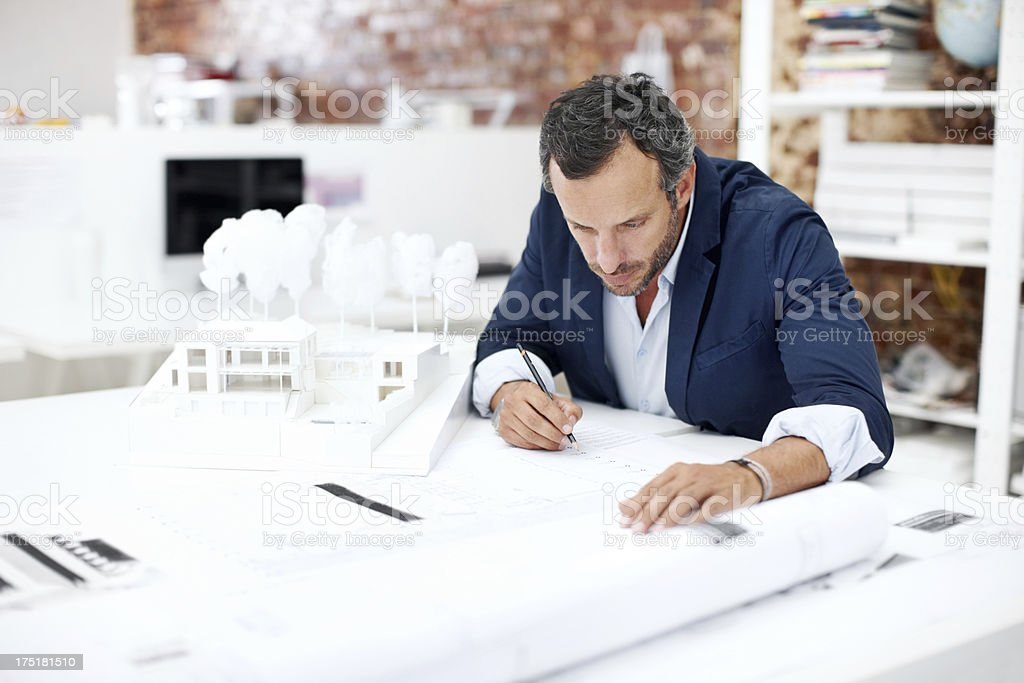 His keen eye for detail is indispensable stock photo