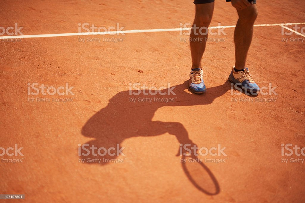 His shadow is a permanent feature of the court royalty-free stock photo