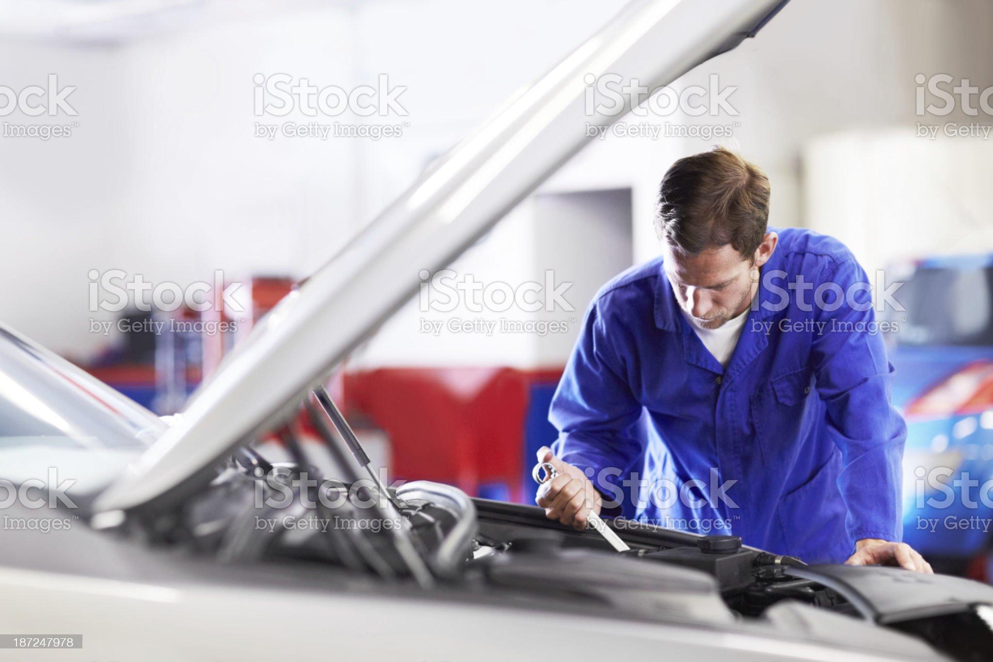 His skill ensures perfect engine maintenance royalty-free stock photo