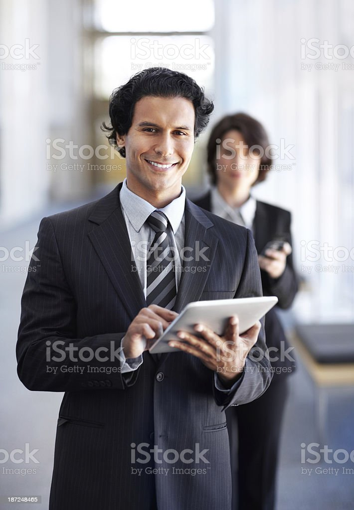 His tablet is an invaluable business tool royalty-free stock photo