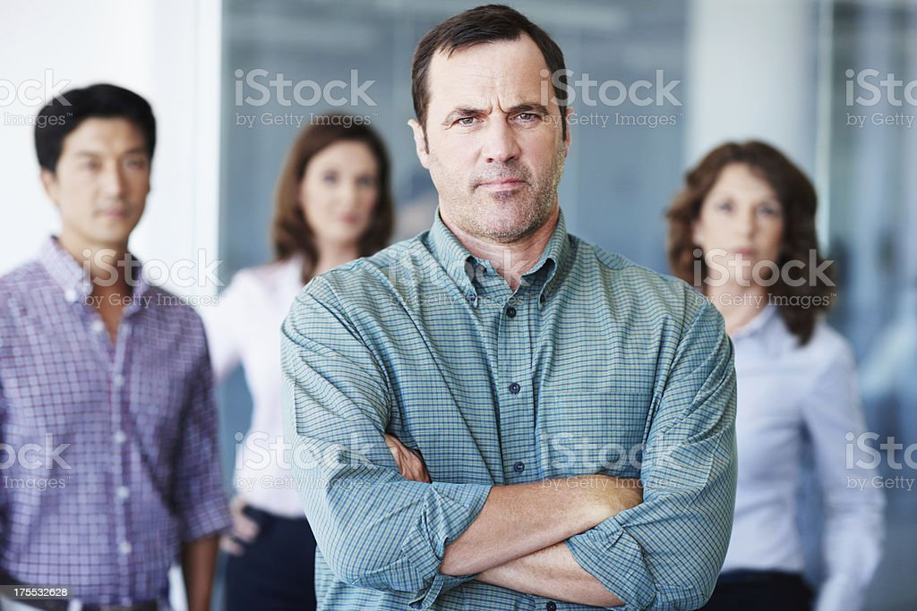 His team looks to him for guidance royalty-free stock photo
