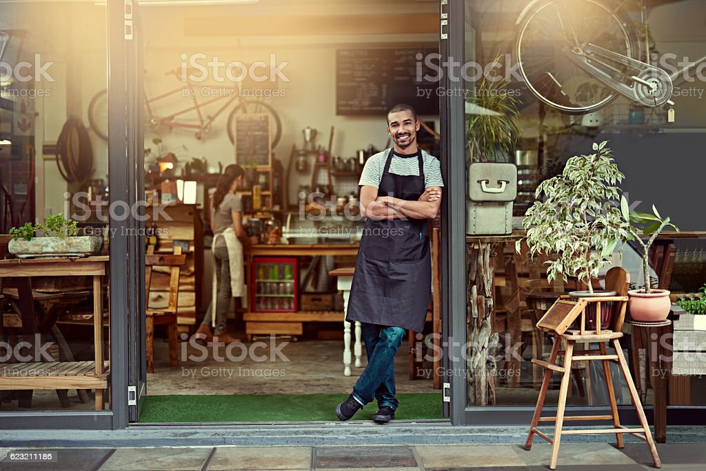 His welcoming smile makes a great first impression stock photo