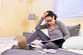 Hispanic adult female stressed while working at home