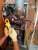 Hispanic air conditioning repair man fixing system