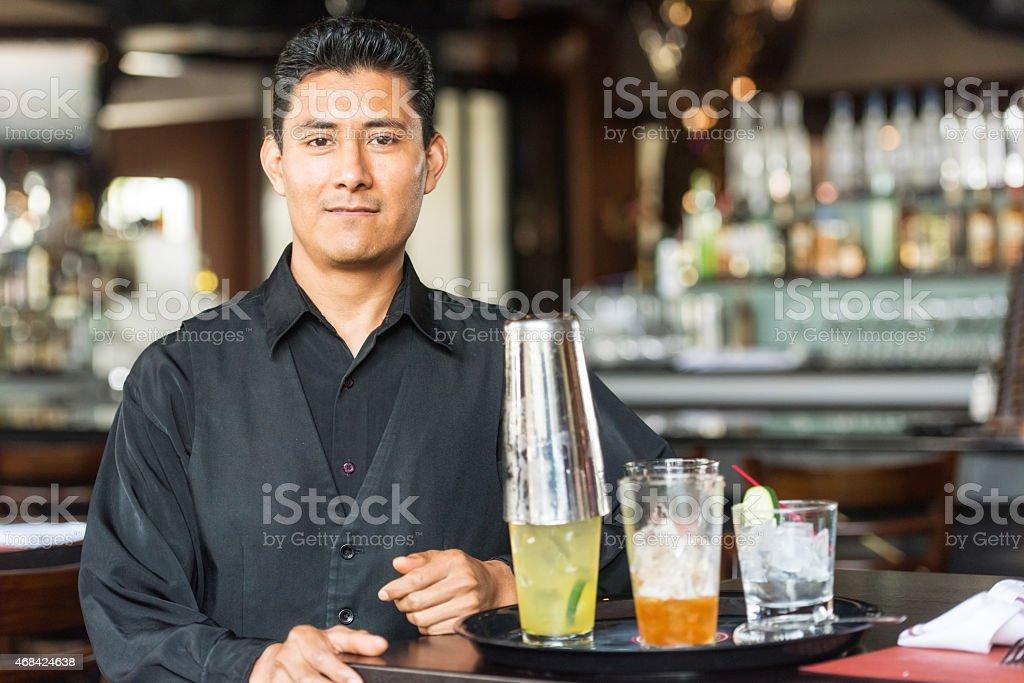 Hispanic Bartender stock photo