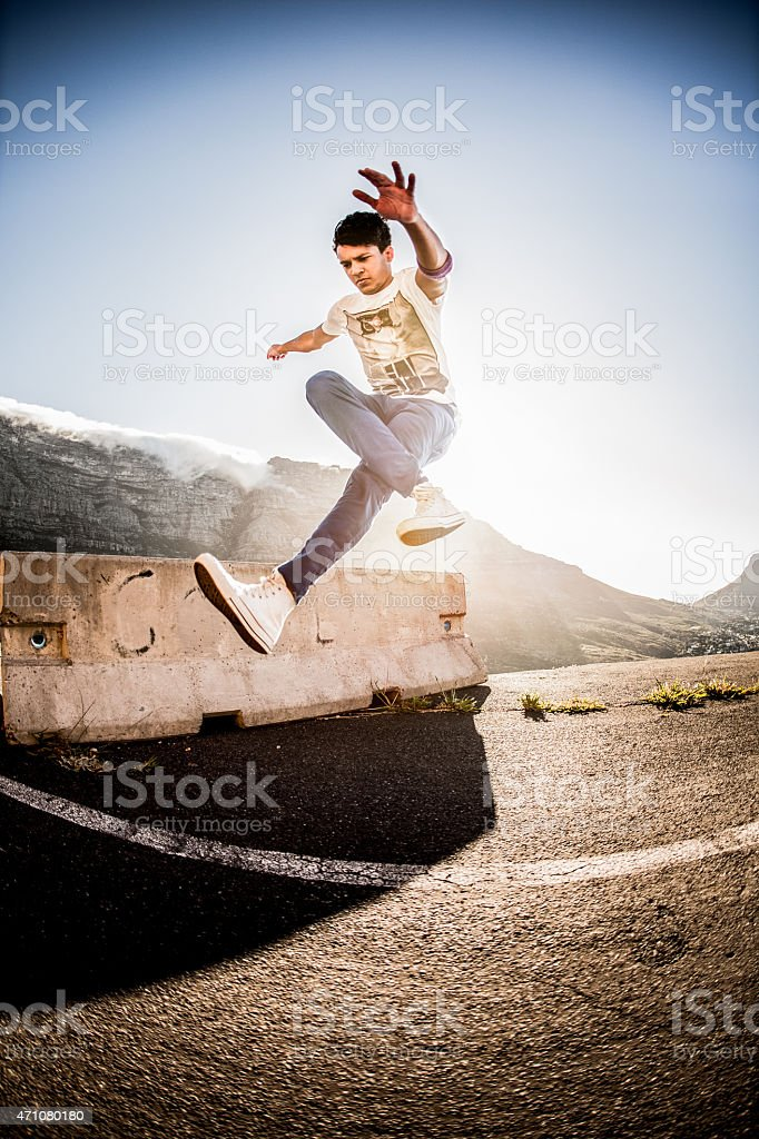 Hispanic b-boy practicing his parkour and breakdancing moves stock photo