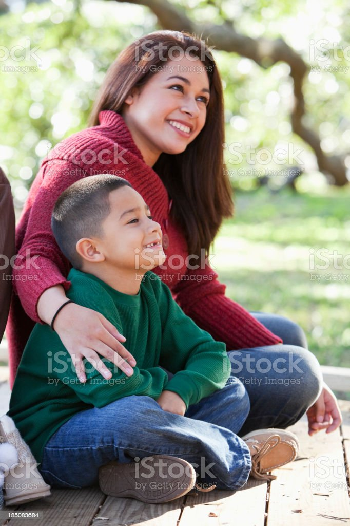 Hispanic boy with mother in park. stock photo