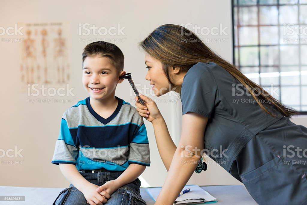 Hispanic Boy's Pediatrician Visit stock photo