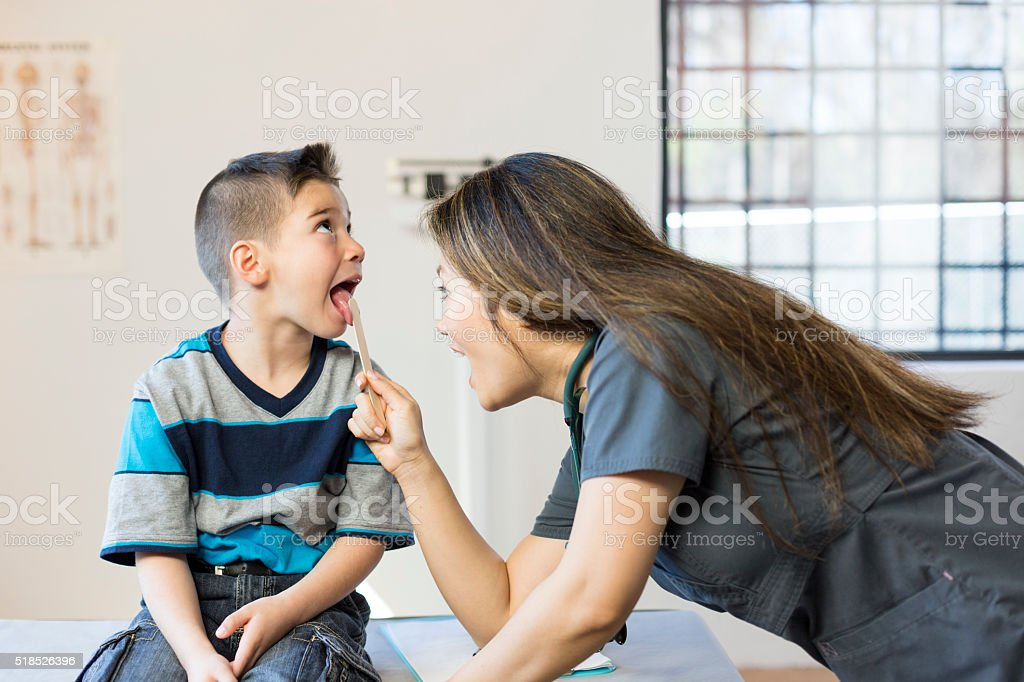 Hispanic Boy's Pediatrician Visit, Throat stock photo