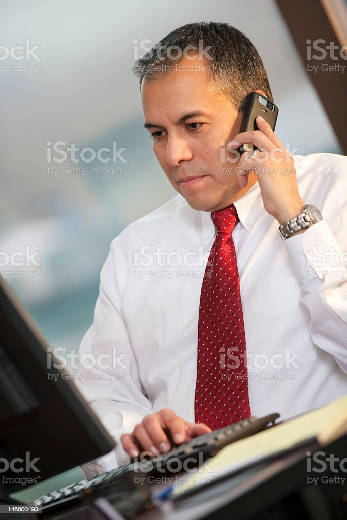 Hispanic Business Man Talking On Cellphone royalty-free stock photo