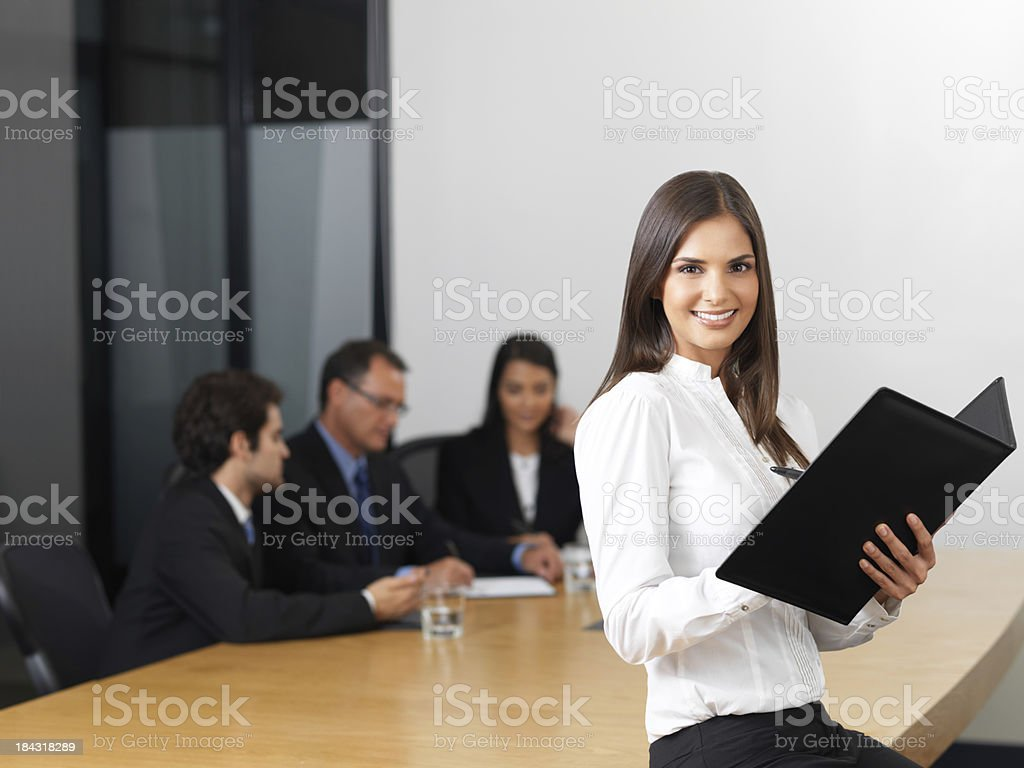 Hispanic business woman and her team royalty-free stock photo