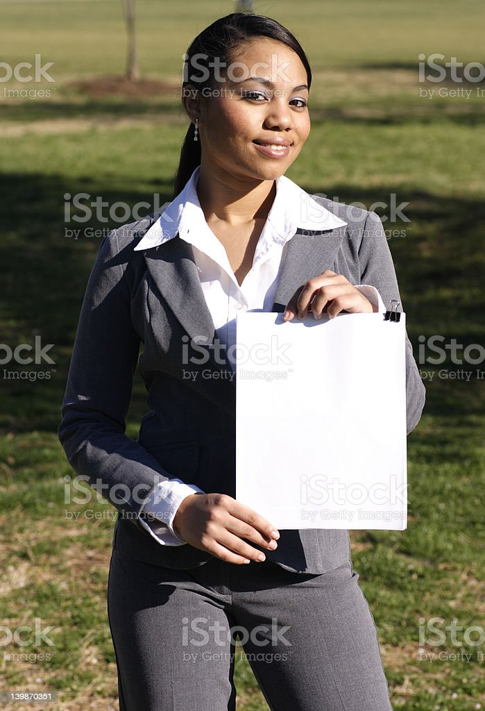 Hispanic Business woman holding a blank sign stock photo