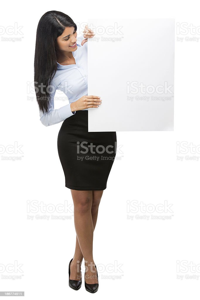 Hispanic business woman looking at a blank sign royalty-free stock photo