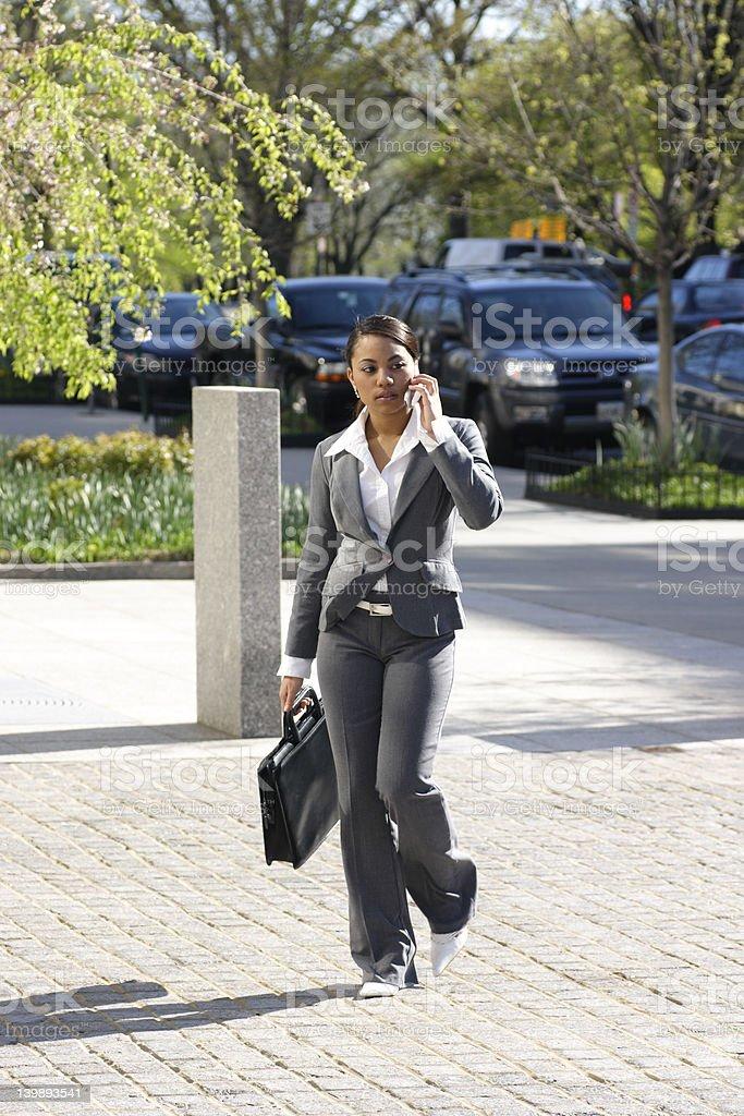 Hispanic Business Woman Strolling royalty-free stock photo