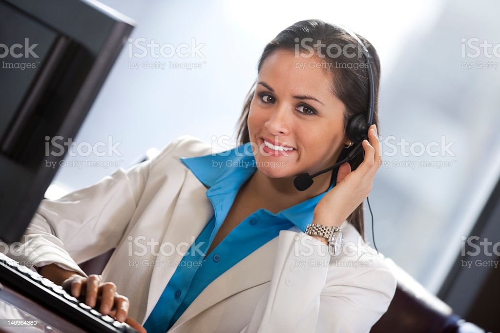Hispanic Business Woman Wearing Headset And Smiling royalty-free stock photo