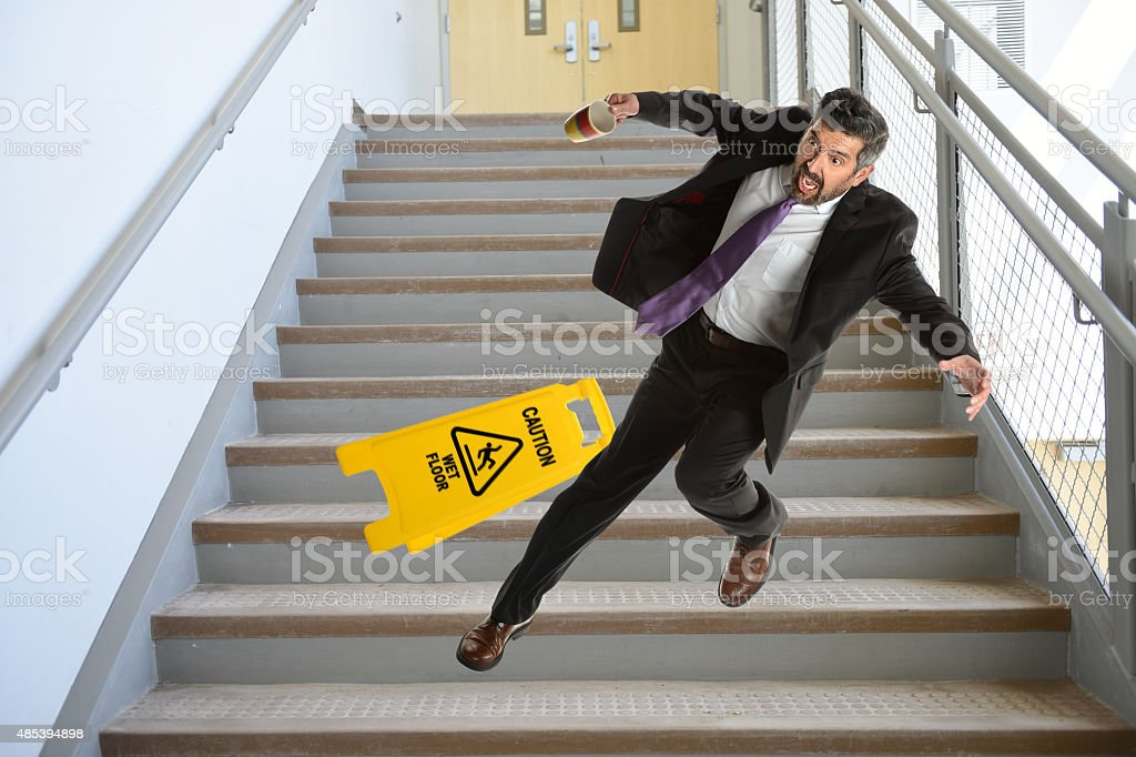 Hispanic Businessman Falling on stairs stock photo