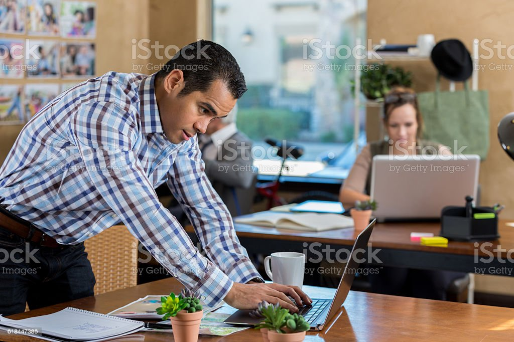 Hispanic businessman is busy at the office stock photo