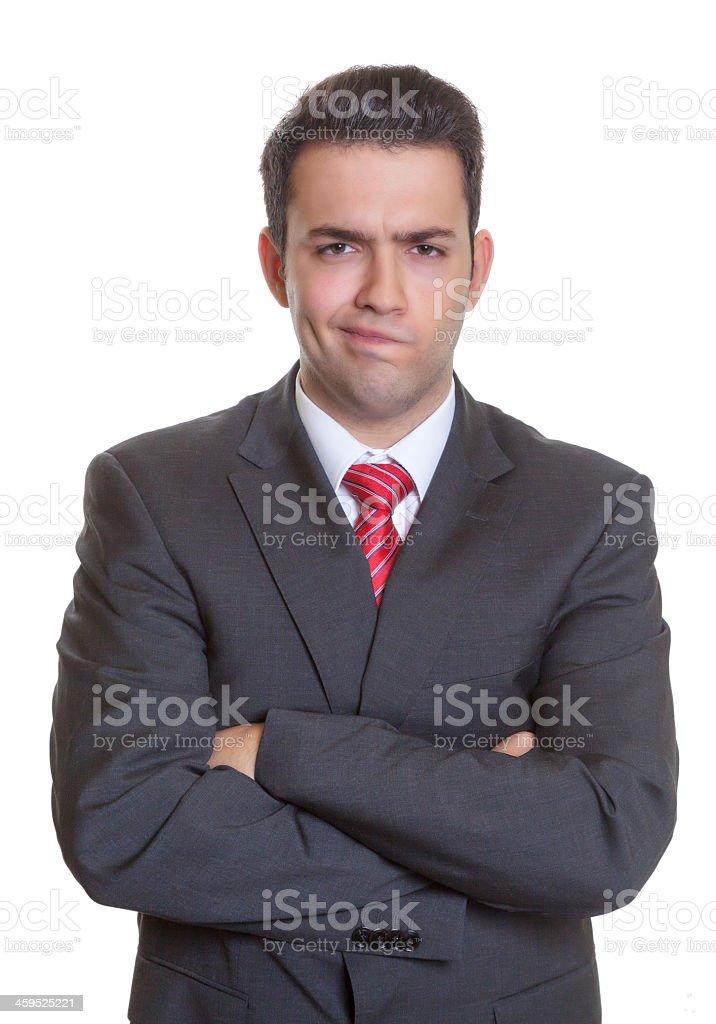 Hispanic businessman with arms crossed and smirking stock photo