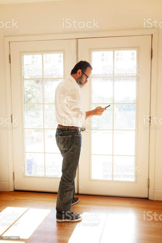 Hispanic Businessman Working From Home On His Mobile Phone stock photo
