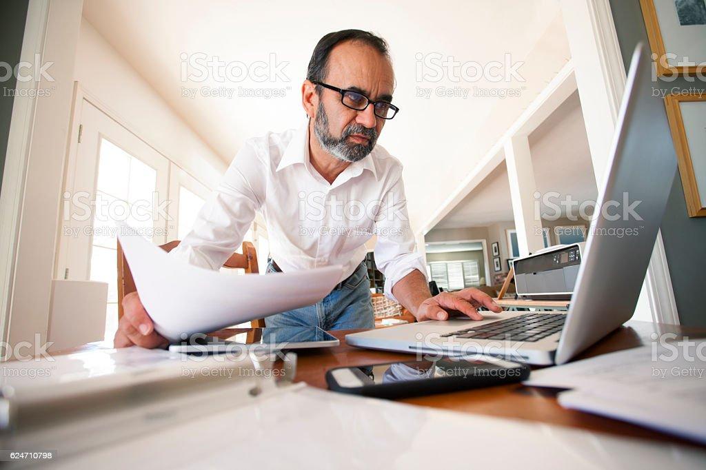 Hispanic Businessman Working From Home stock photo