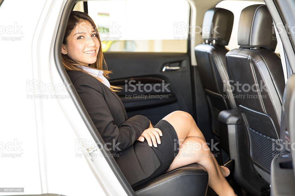 Hispanic businesswoman in a car stock photo