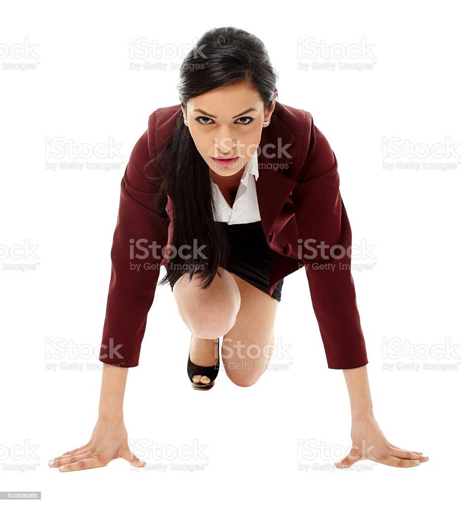 Hispanic businesswoman preparing for race stock photo