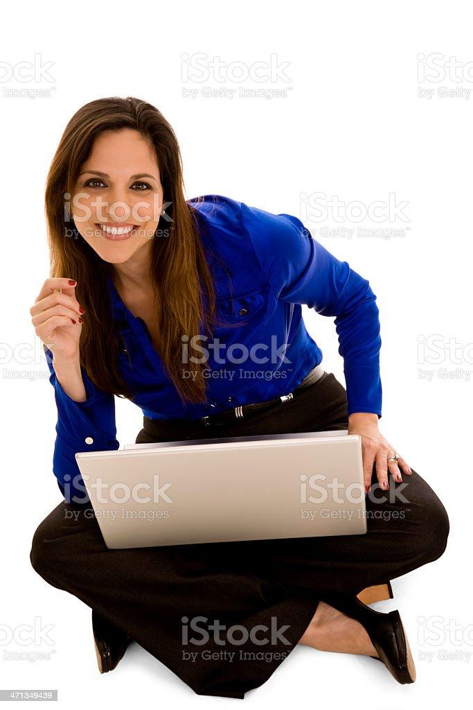 Hispanic Businesswoman sittting on floor with laptop stock photo