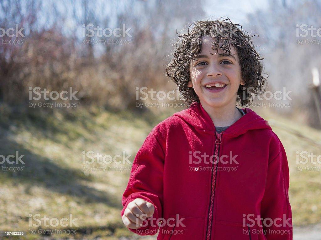 Hispanic Child Walking in a Park royalty-free stock photo
