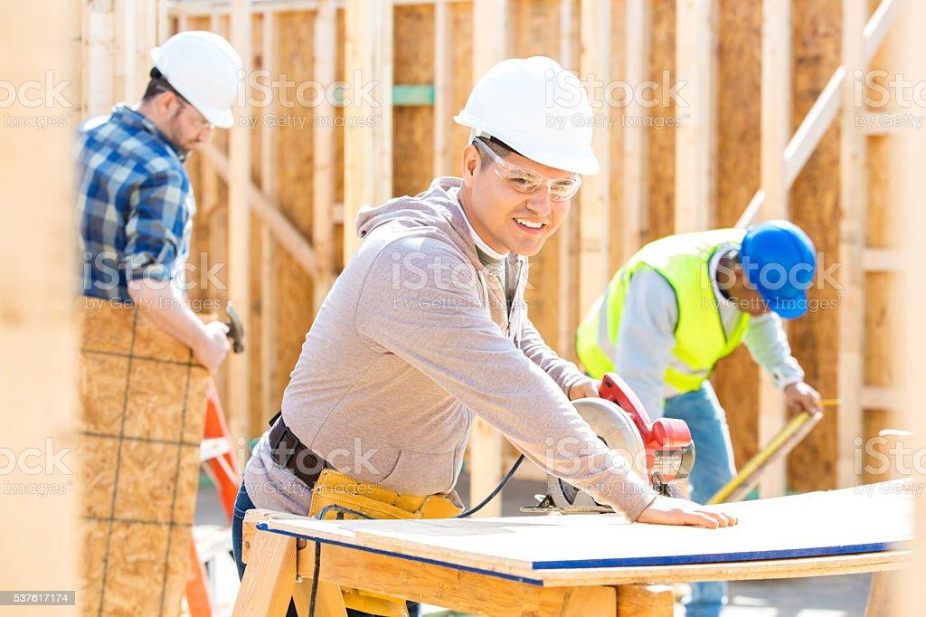Hispanic construction worker at job site stock photo