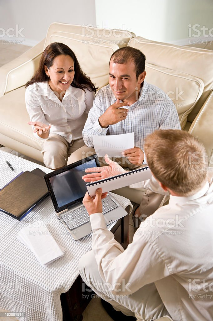 Hispanic couple at home meeting with professional financial plan royalty-free stock photo