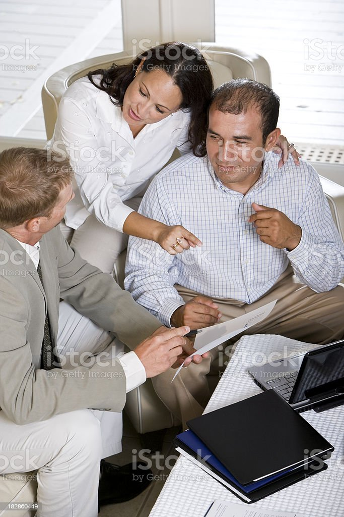 Hispanic couple at home talking with professional financial plan royalty-free stock photo