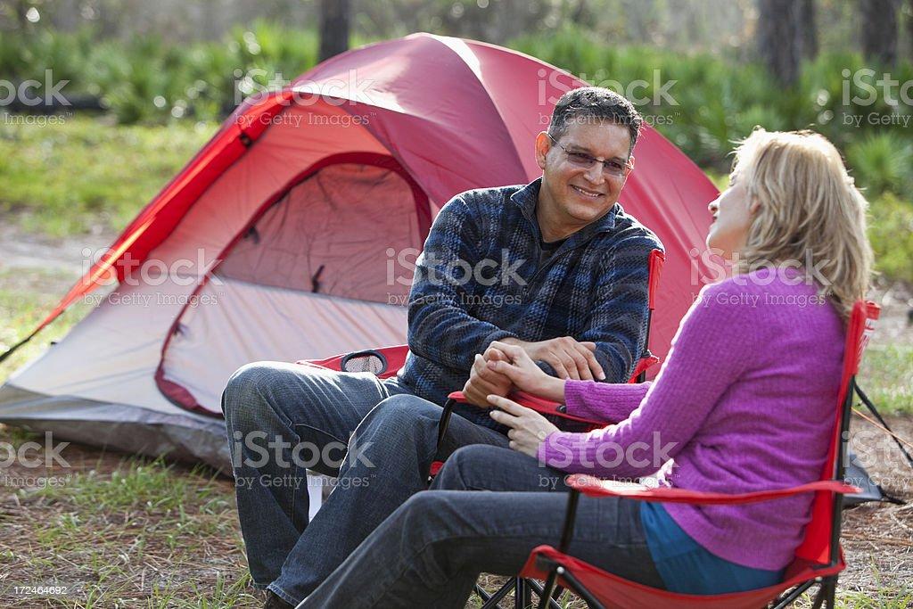 Hispanic couple camping stock photo