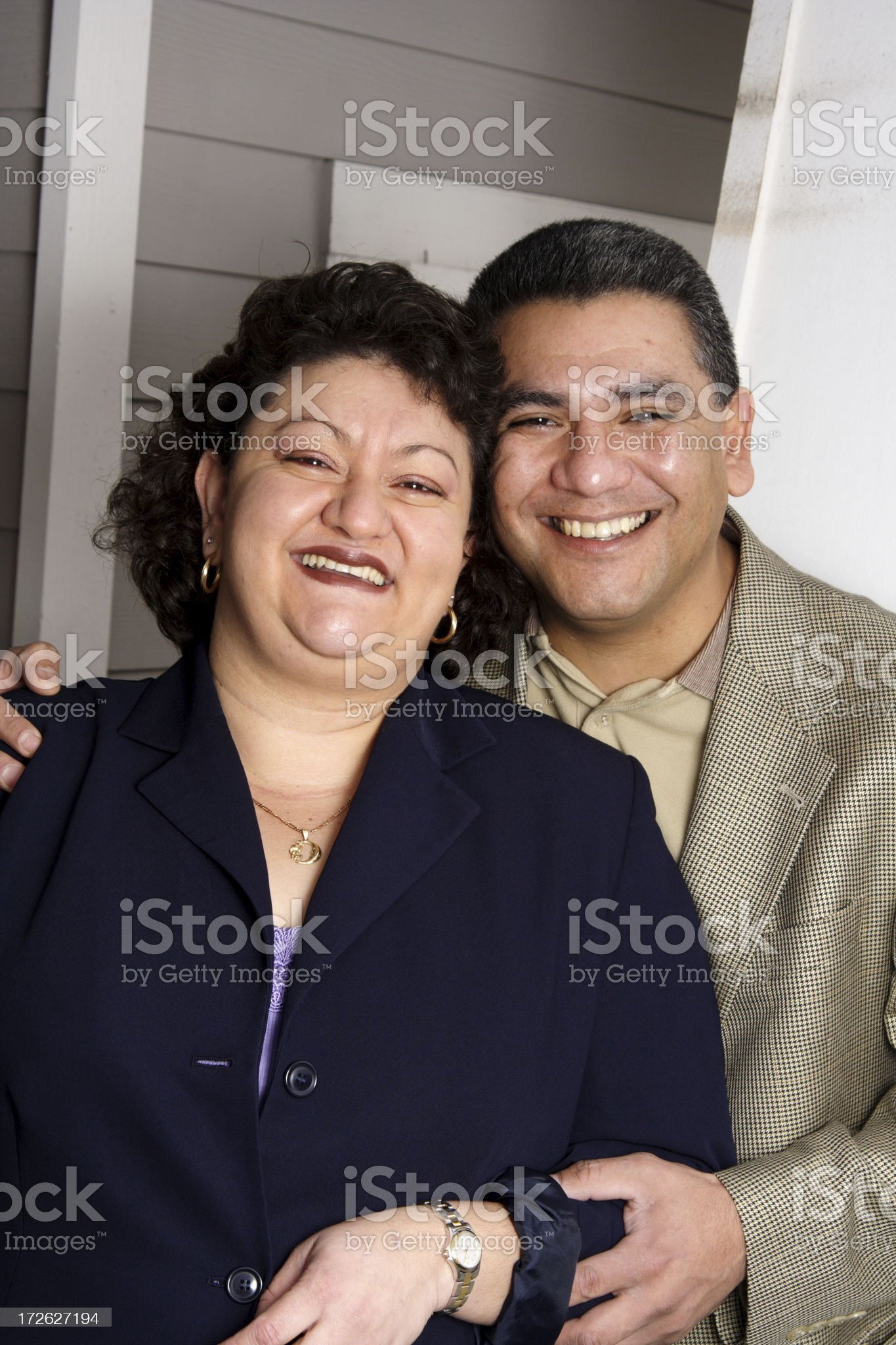 hispanic couple in front of their home royalty-free stock photo